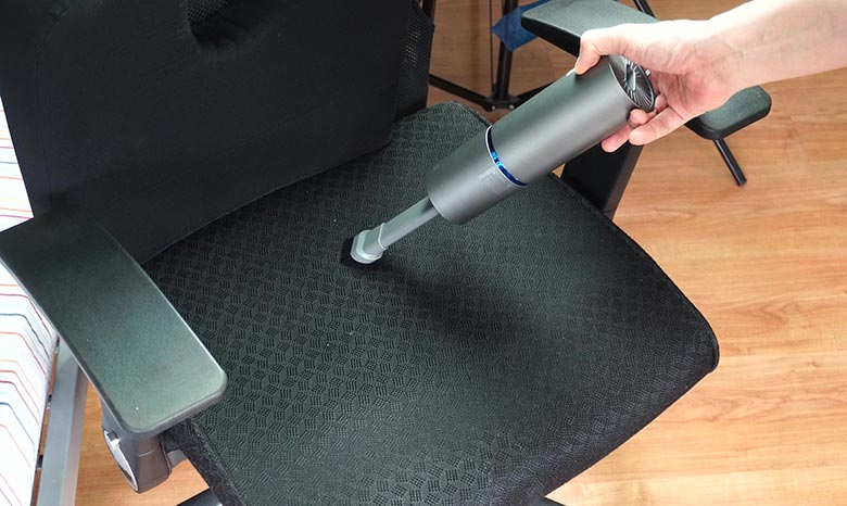 Brigii cleaning an office chair