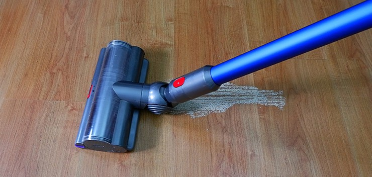 Dyson V11 cleaning sand on hard floors