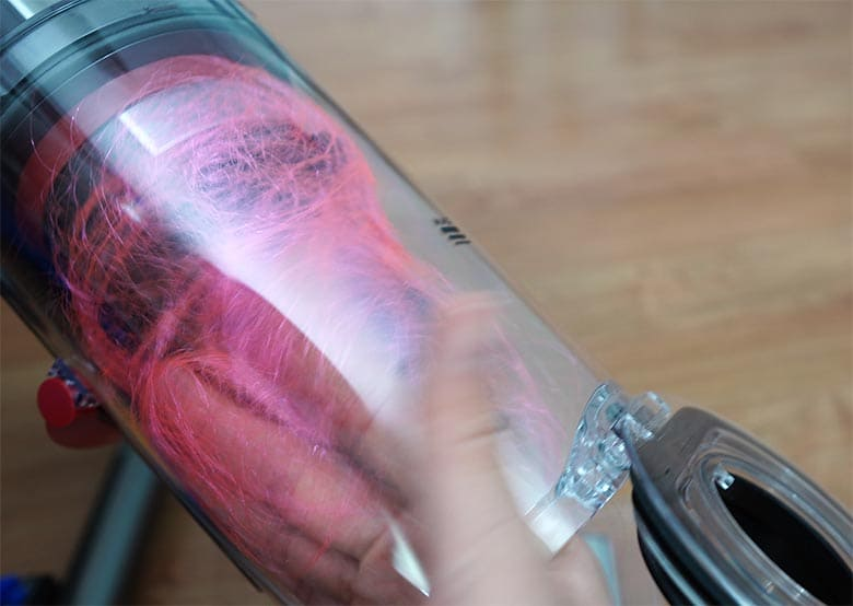 Dyson V15 using hands to remove long hair strands