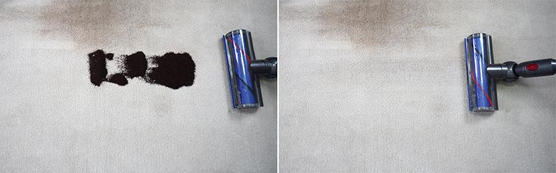 Dyson V7 cleaning coffee grounds on mid pile carpet