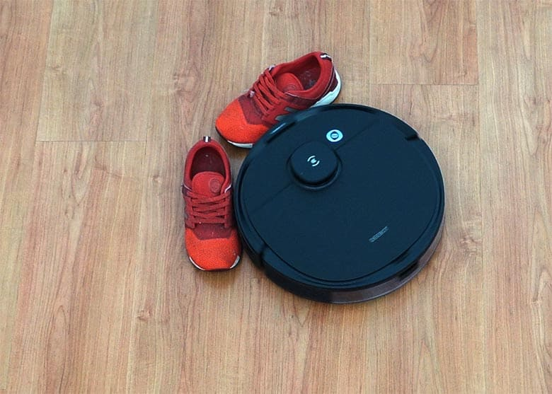 Ecovacs N8 Pro nudging against red shoe