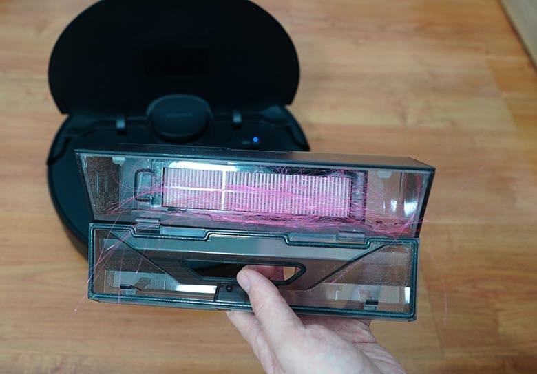 Hair inside Mova L600's dustbin